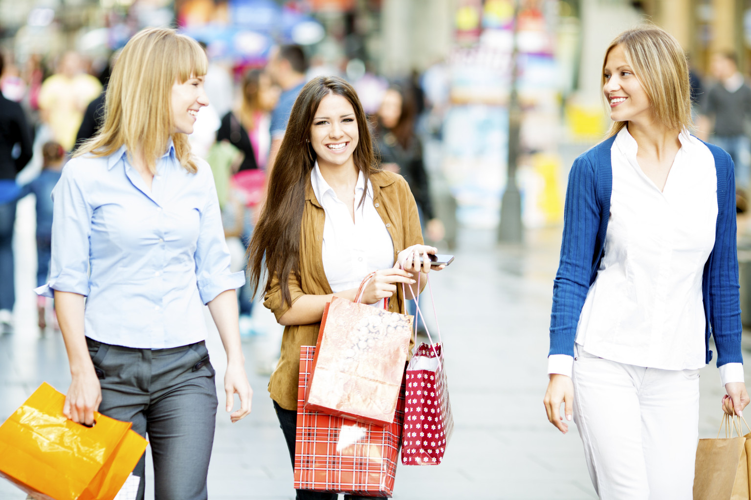 Cheerful Young Women Shopping.